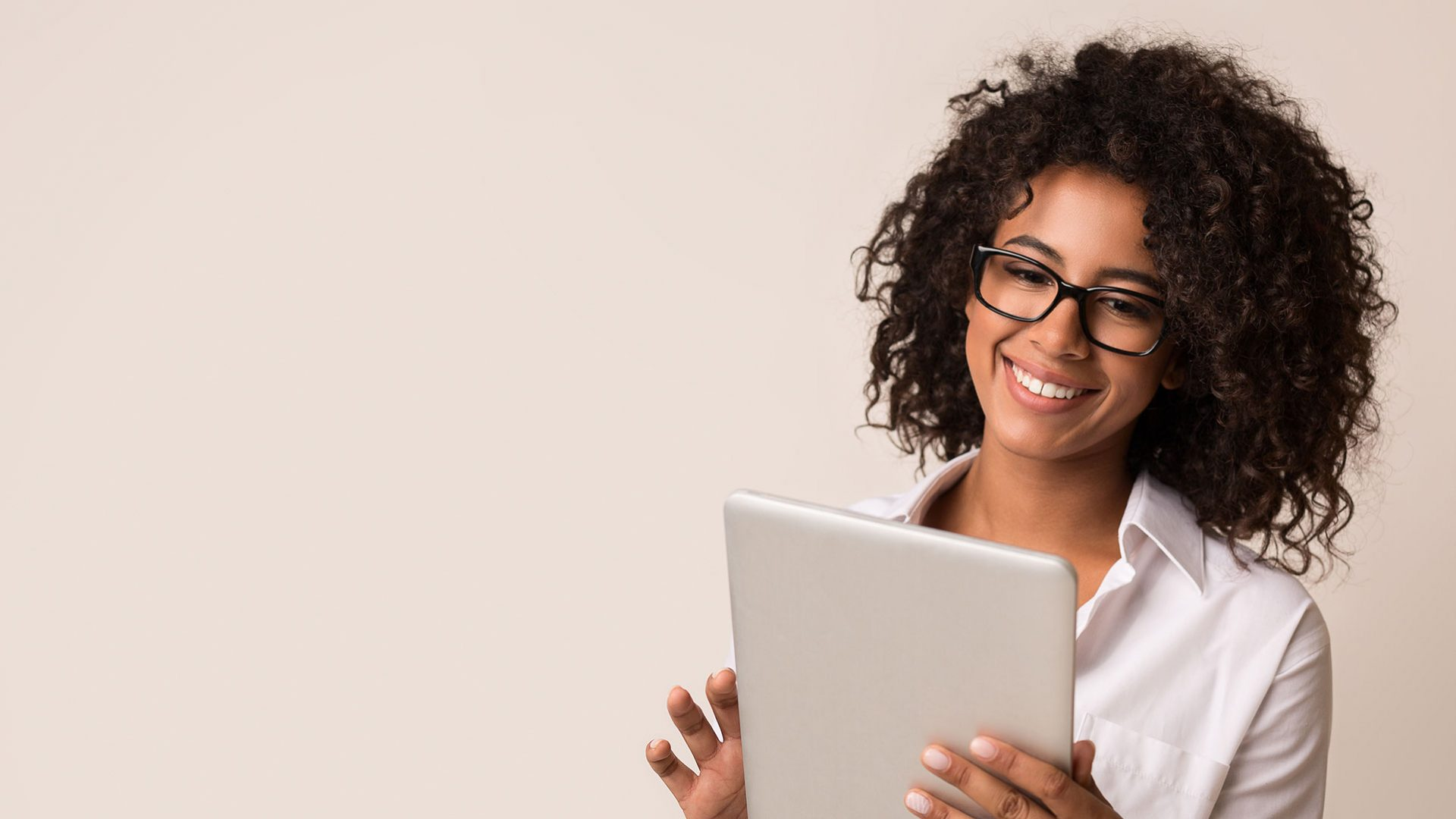 woman holding a tablet and smiling