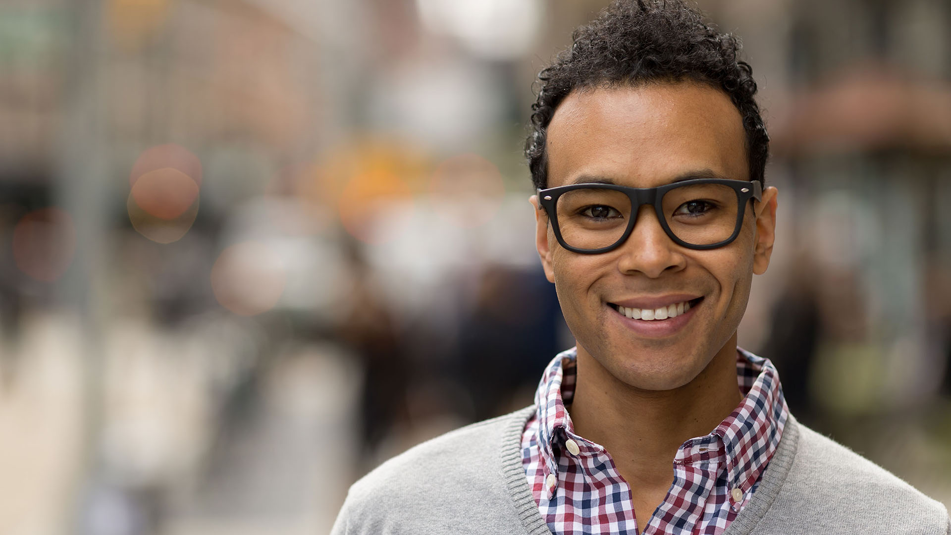 man of color with nice glasses smiling